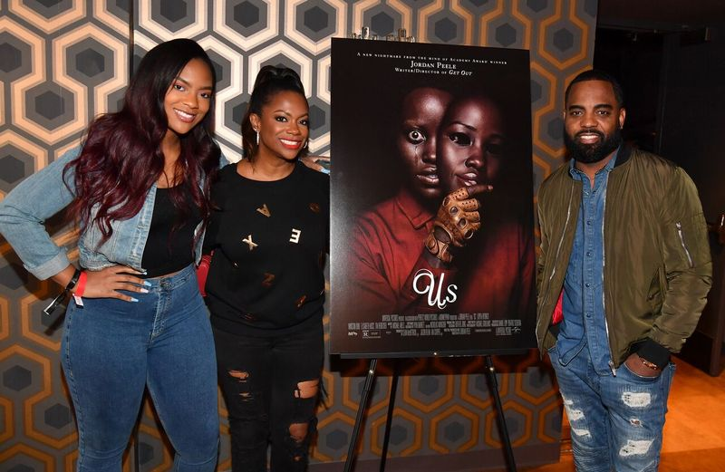 "Kandi Burruss, Riley Burruss, and Todd Tucker at an ""Us"" viewing 