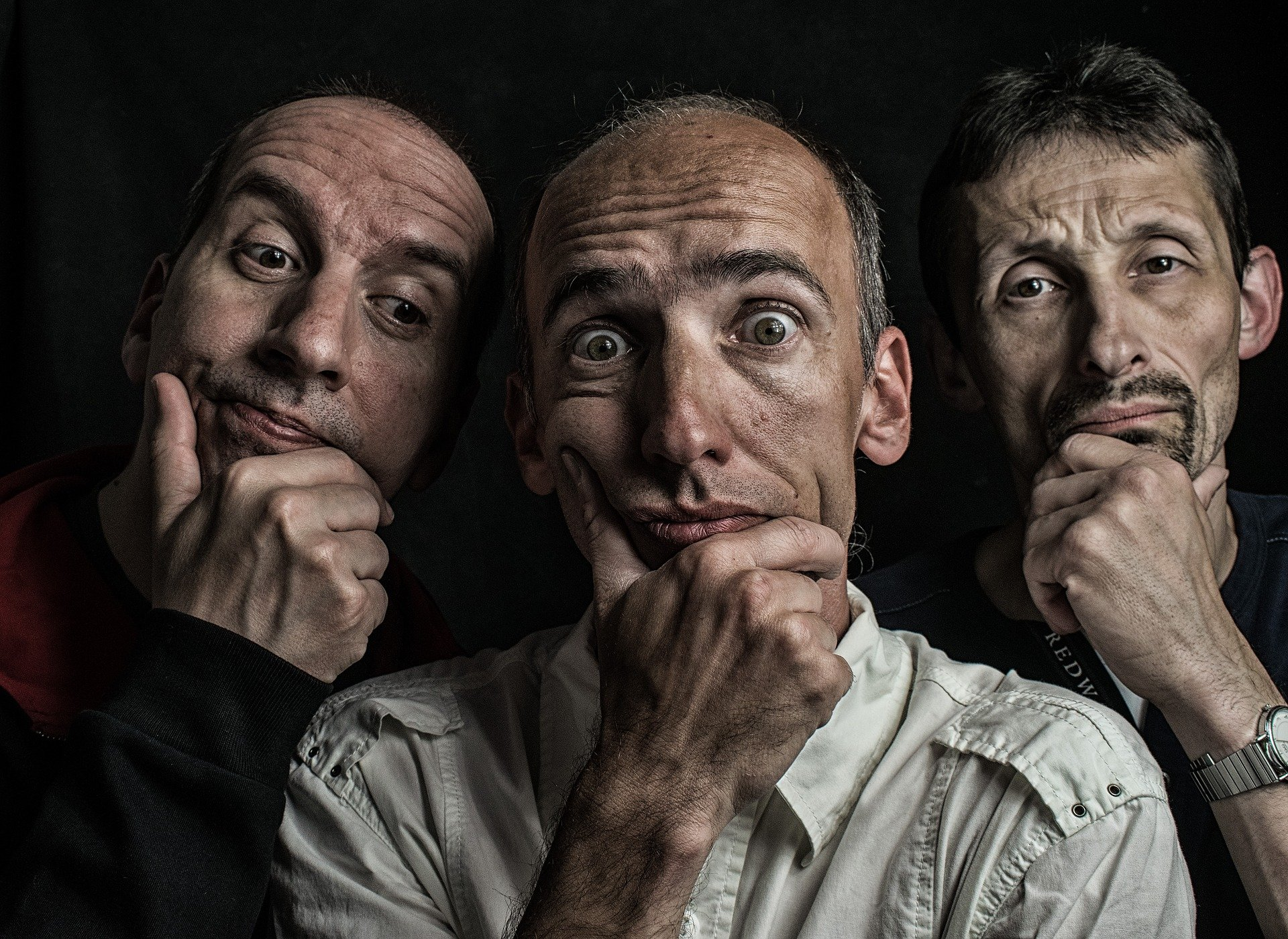 Three men with their hands against their chins while looking thoughtful   Photo: Pixabay/Szilárd Szabó