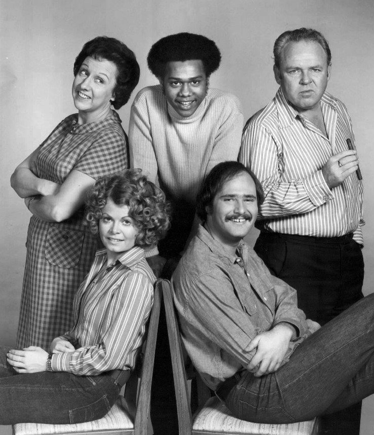 """Cast of  """"All In the Family"""" in 1973. Standing, from left: Jean Stapleton (Edith Bunker), Mike Evans (Lionel Jefferson), Carroll O'Connor (Archie Bunker). Seated: Sally Struthers (Gloria Bunker Stivic) and Rob Reiner (Mike Stivic). 