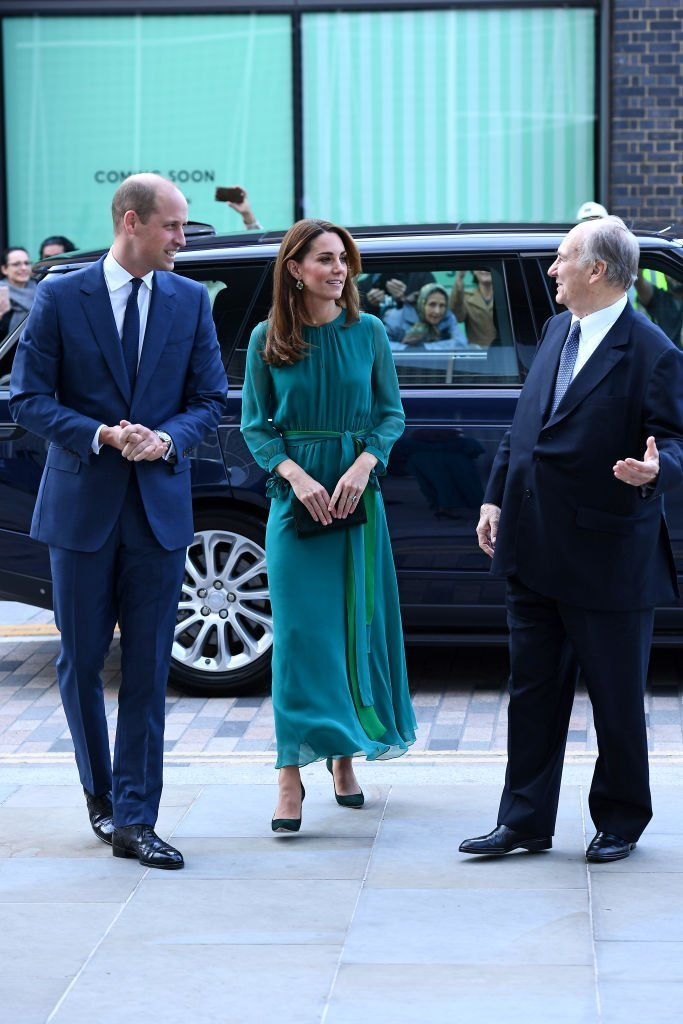 Prince William and Kate Middleton are greeted by Prince Shah Karim Al Hussaini, Aga Khan IV during a visit to the Aga Khan Centre. | Source: Getty Images