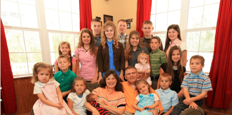 """Stars from """"Bringing Up the Bates: Parents: Gil and Kelly Bates and their brood, from Back Row: Lawson, Zach, Nathan, Middle Row: Josie, Alyssa, Erin, Michaella holding Callie-Anna 13 months, Trace, Tori, Front: Addallee, Jackson, Katie, Kelly holding Judson Wyatt, Gil, Ellie, Warden, Carlin and Isaiah at home on September 26, 2010 in Lake city, Tennessee 