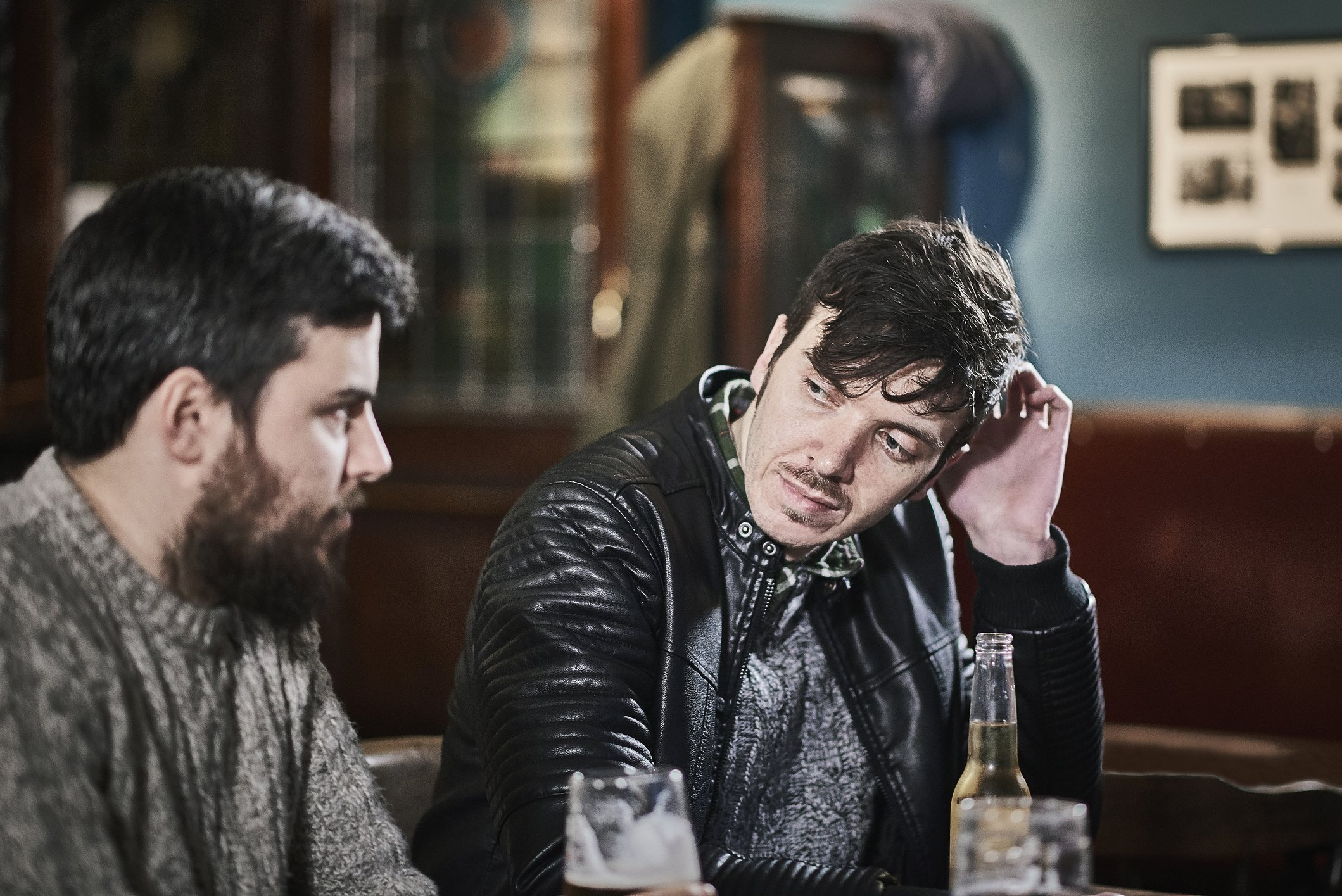 Two friends drinking together in a traditional British pub.   Photo: Getty Images