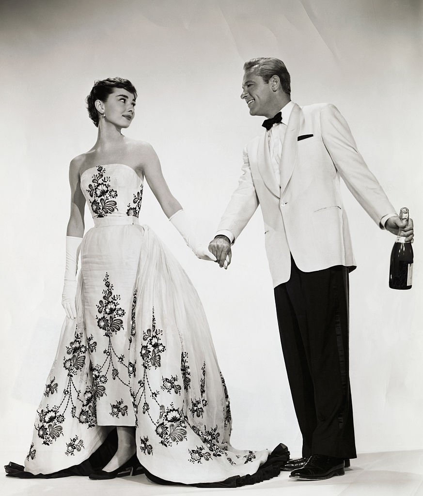 """Audrey Hepburn and William Holden get into character as the ugly duckling-turned-beauty queen Sabrina Fairchild and charming millionaire playboy Linus Larrabee, respectively in """"Sabrina"""" circa 1954. 