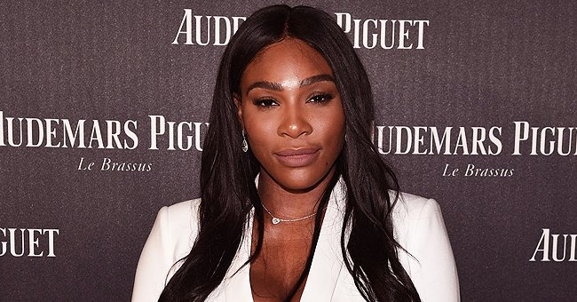 Watch Serena Williams Flaunt Her Elegance in a One-Shoulder White Dress with Deep Slit & Pants