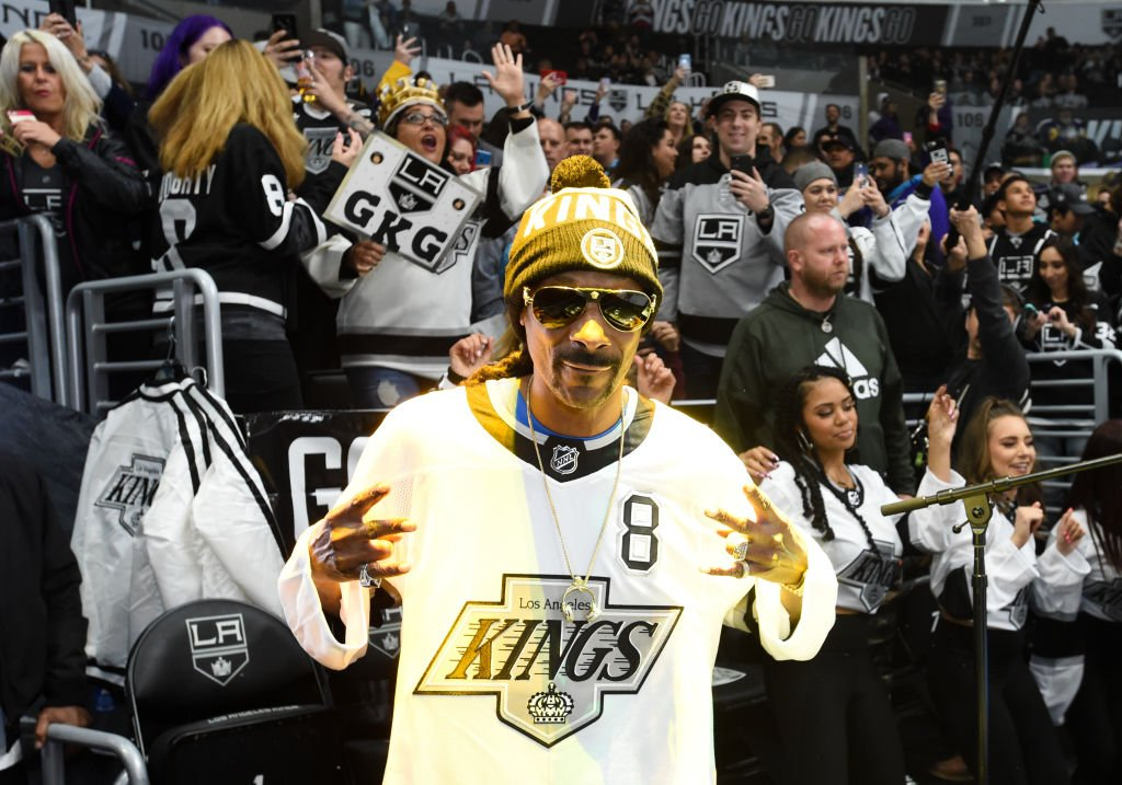 """Snoop Dogg performs as """"DJ Snoopadelic"""" during warmups before the game between the Colorado Avalanche and the Los Angeles Kings