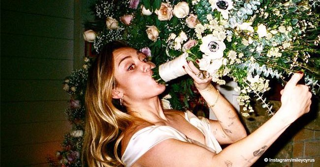 Miley Cyrus pretends to smoke her wedding bouquet like a bong in a series of bizarre new photos