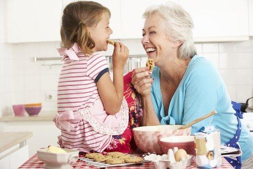 A grandmother and her granddaughter baking in the kitchen. | Source: Shutterstock.