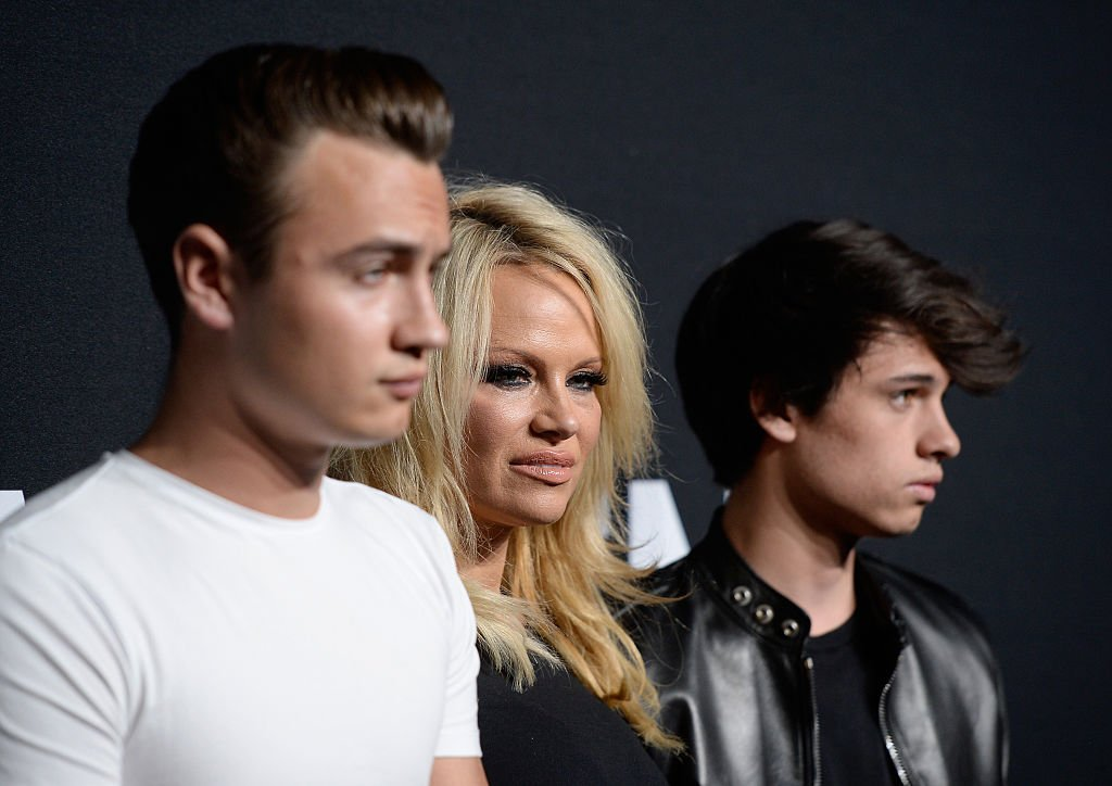 Pamela Anderson and her sons Brandon Lee (L) and Dylan Lee attend the Saint Laurent show at The Hollywood Palladium on February 10, 2016 in Los Angeles, California.  | Photo: GettyImages