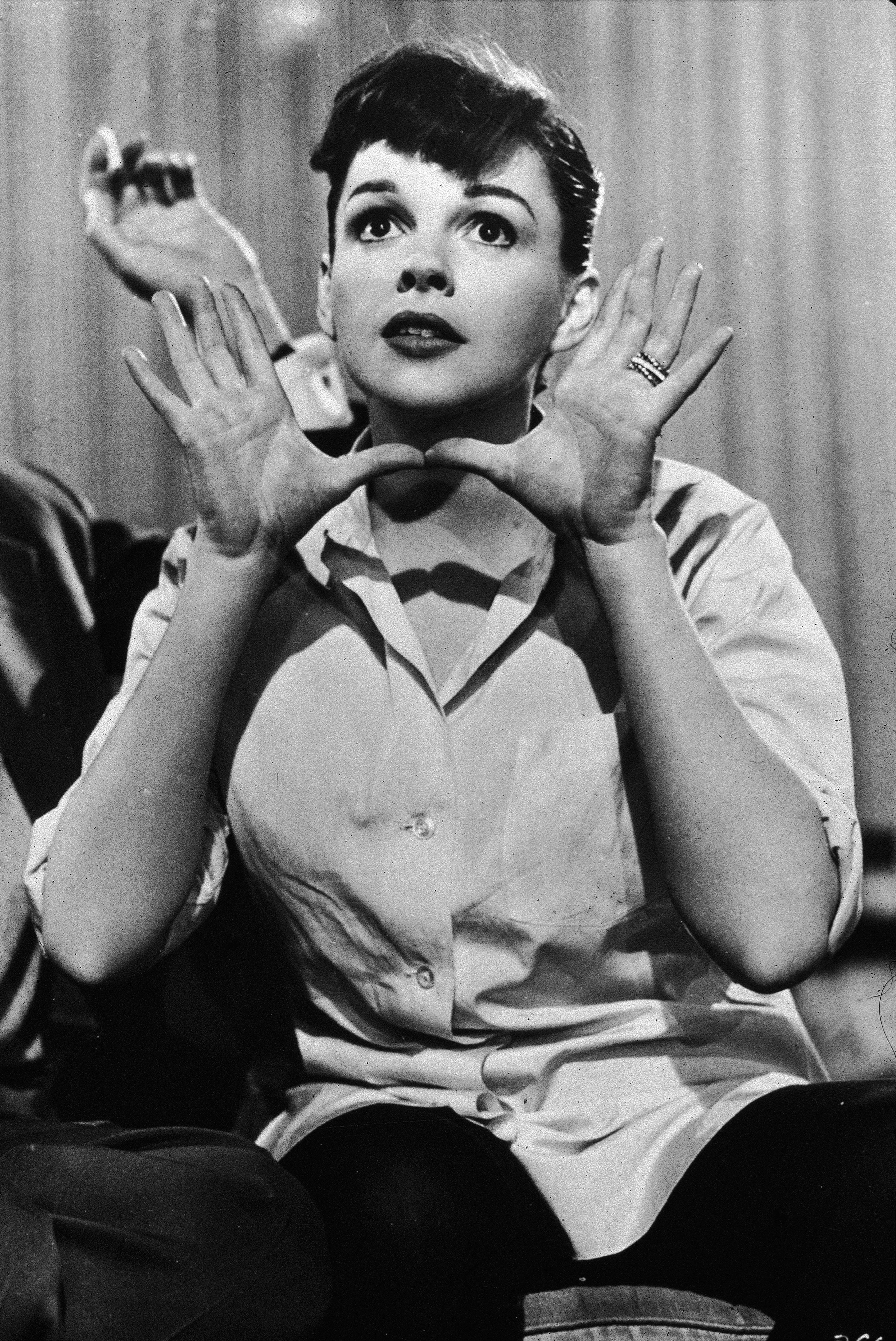 Judy Garland (1922-1969) holds her hands up near her face, circa 1950s. | Source: Getty Images