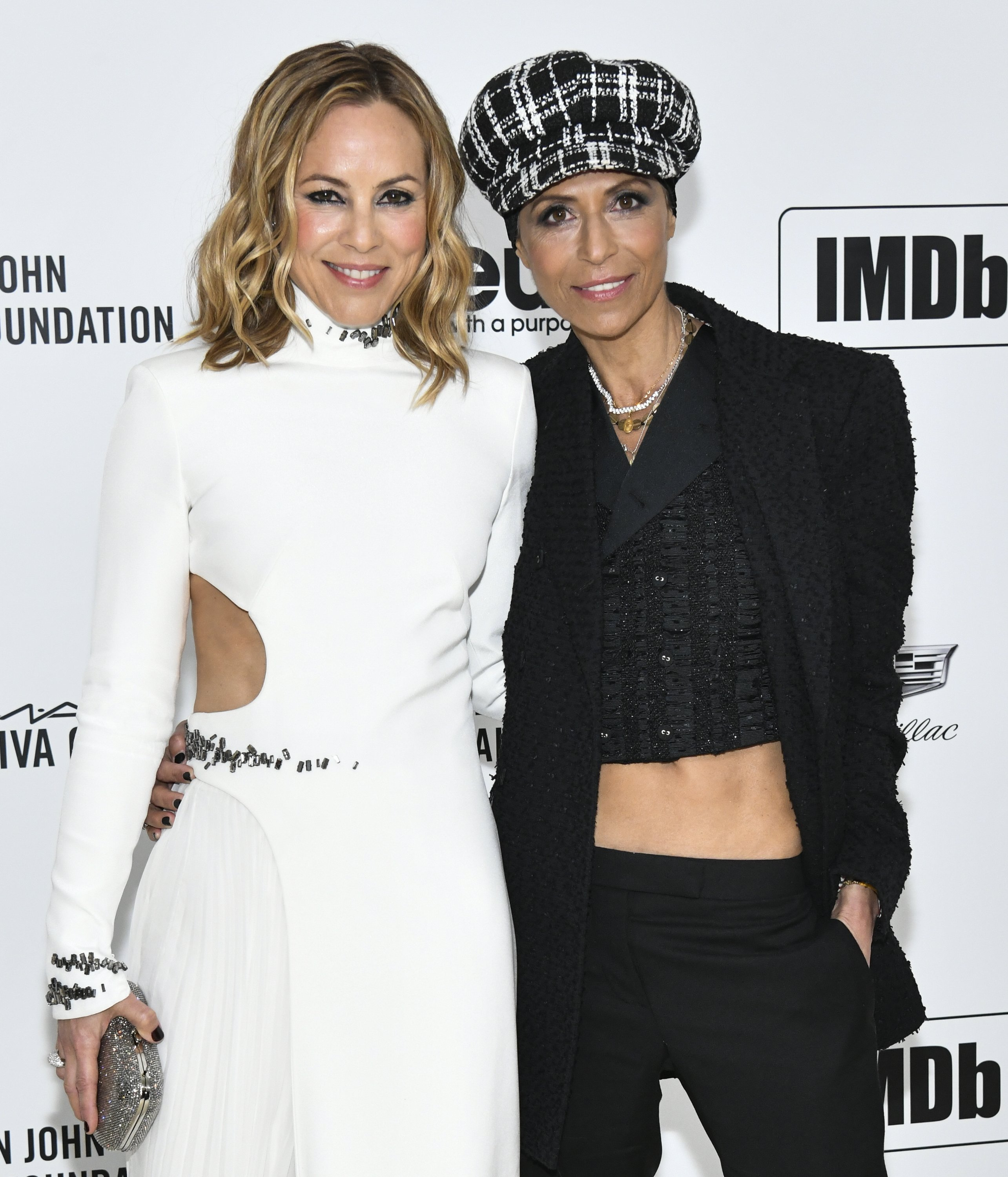 Maria Bello and Dominique Crenn attend the 28th Annual Elton John AIDS Foundation Academy Awards Viewing Party on February 09, 2020, in West Hollywood, California. | Source: Getty Images.