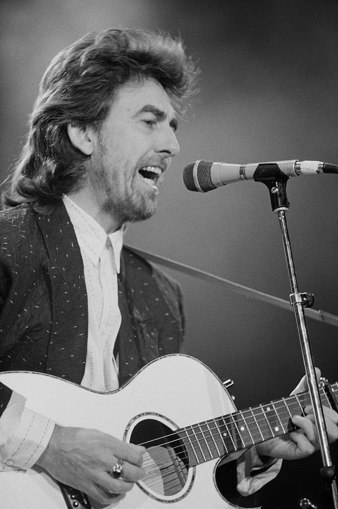 Former Beatle George Harrison (1943 - 2001) performing at the Prince's Trust Concert, Wembley Arena, London | Getty Images / Global Images Ukraine