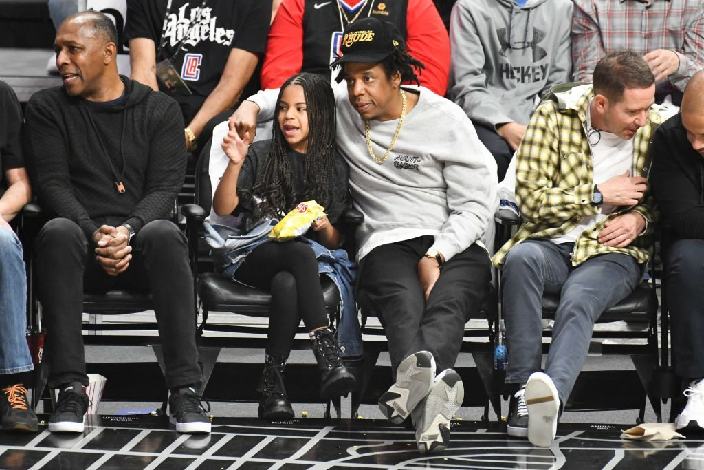 Jay-Z and Blue Ivy Carter attend a basketball game between the Los Angeles Clippers and the Los Angeles Lakers at Staples Center on March 08, 2020. | Photo: Getty Images