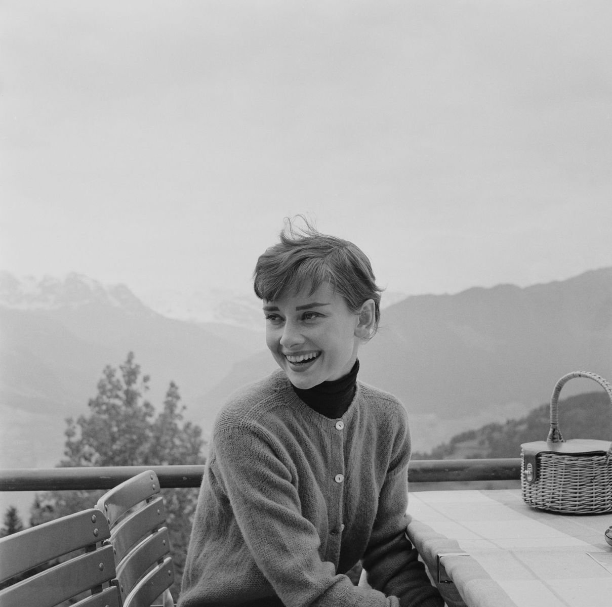 Belgian-born actress Audrey Hepburn (1929 - 1993) on the terrace of the Restaurant Hammetschwand at the summit of the Bürgenstock on January 01, 1955 | Photo: Getty Images