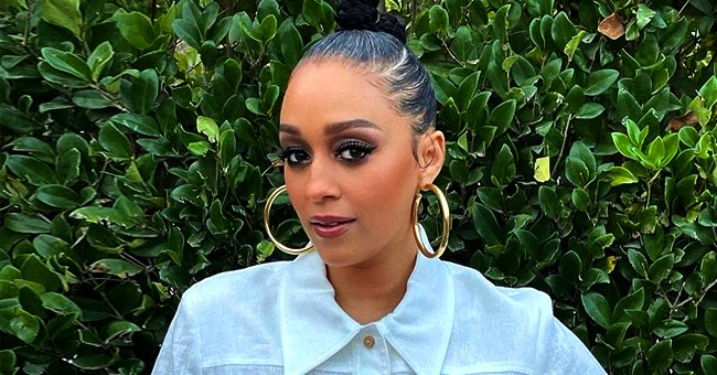 'Sister, Sister' Star Tia Mowry Stuns in White Dress & Trendy Accessories — See Fan Reactions
