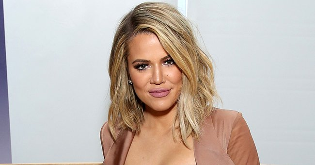 Khloé Kardashian Poses in a Tight Brown Jumpsuit Showing Her Figure Amid Pregnancy Rumors