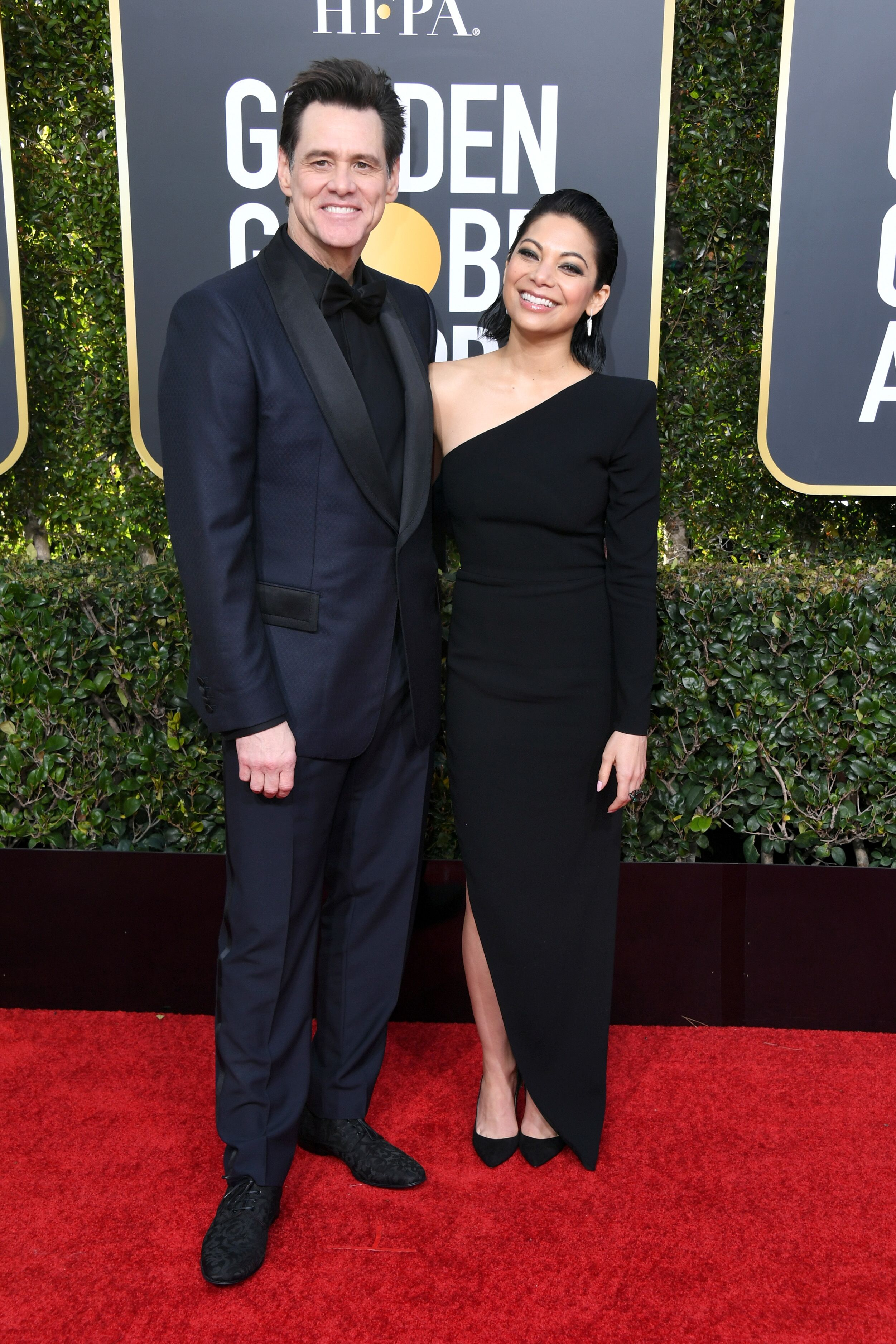 jim Carrey and Ginger Gonzaga attend the 76th Annual Golden Globe Awards. | Source: Getty Images