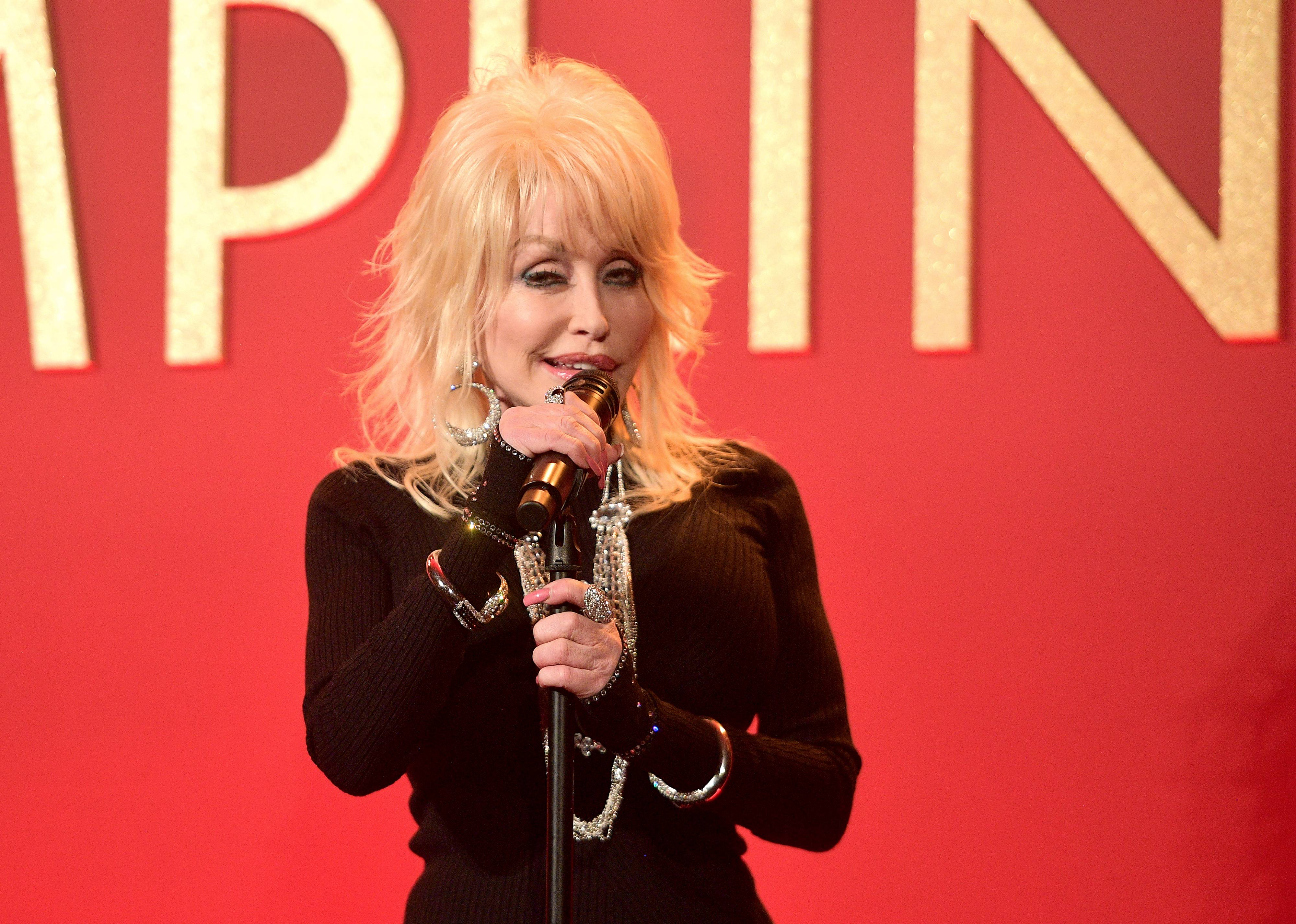 Dolly Parton performing at the luncheon for her Netflix movie, Dumplin | Photo: Getty Images