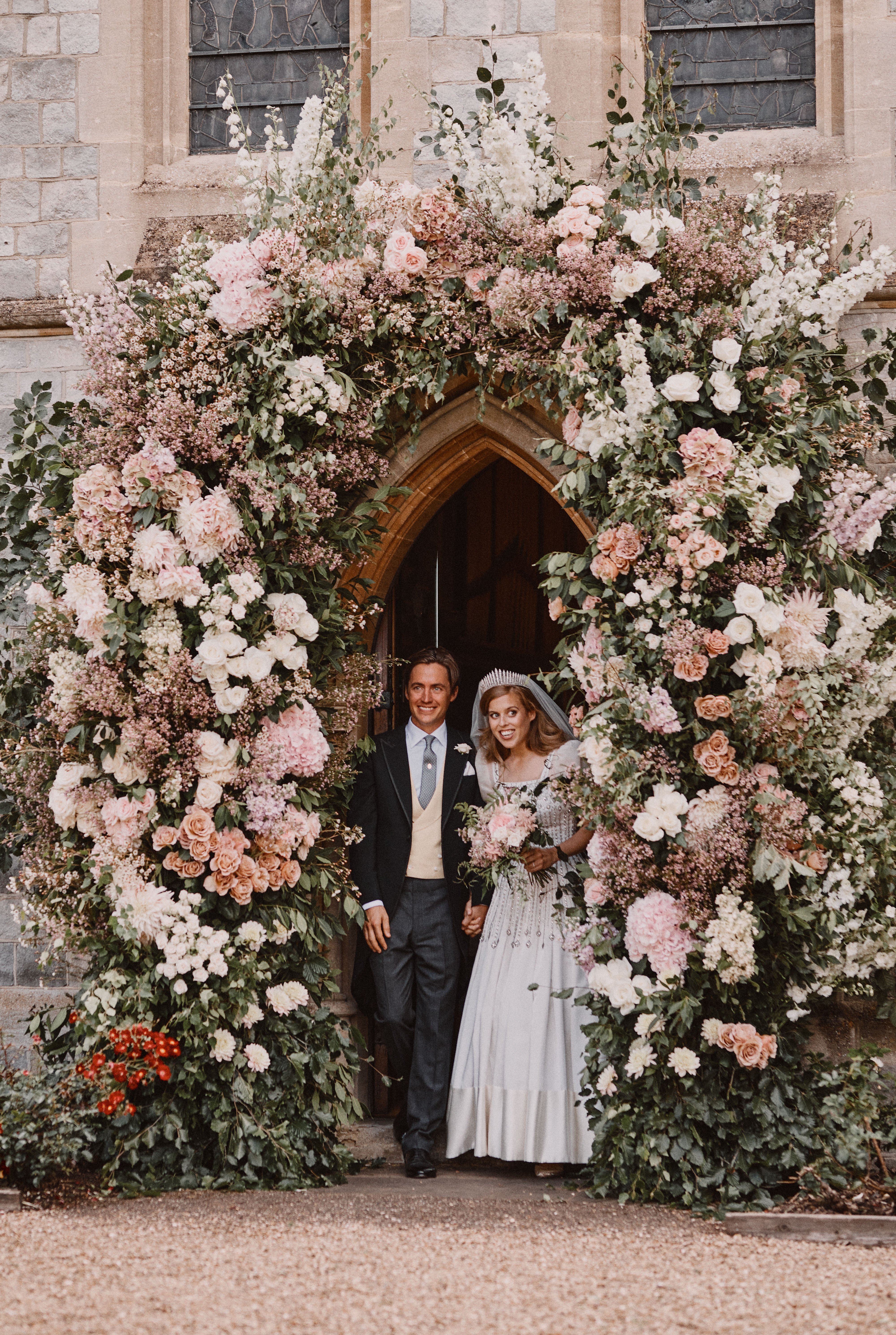 This official wedding photograph released by the Royal Communications of Princess Beatrice and Edoardo Mapelli Mozzi shows them leaving The Royal Chapel of All Saints at Royal Lodge, Windsor after their wedding on July 17th 2020 in Windsor, England. Issue date: Saturday July 18, 2020. | Source: Photo by Benjamin Wheeler - WPA Pool/Getty Images