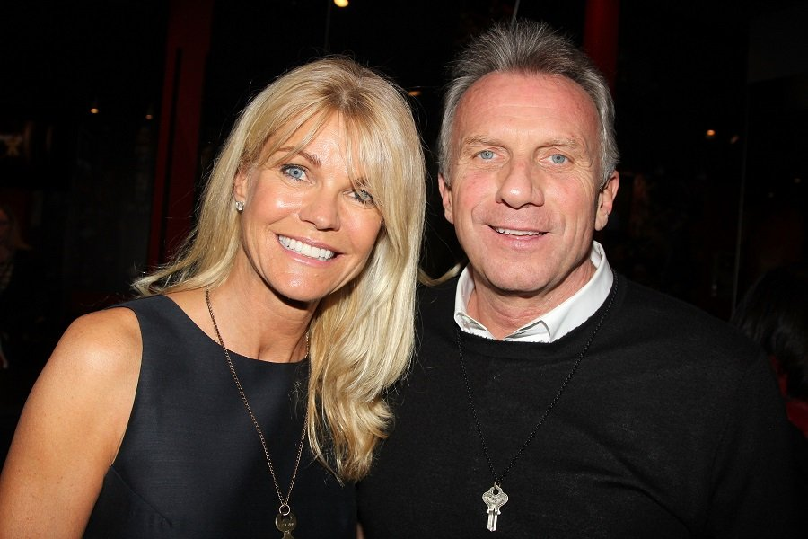 """Joe Montana and Jennifer Montana pictured at a Super Bowl Party and donation of the """"Beast Mode Key"""" necklace at Planet Hollywood Times Square, New York City, 2014. 