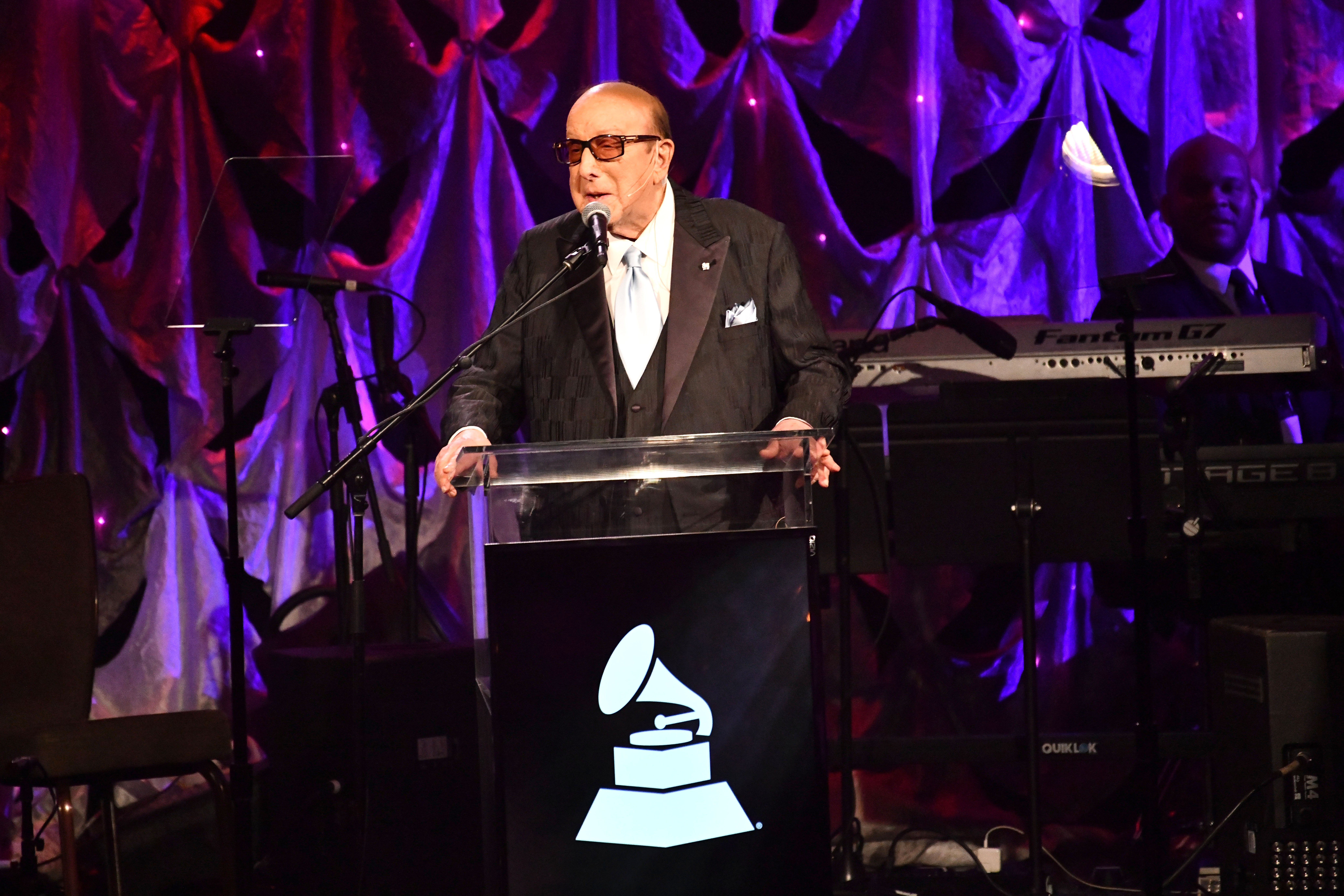 Musical Producer Clive Davis delivering a speech at the pre-Grammys party | Photo: Getty Images