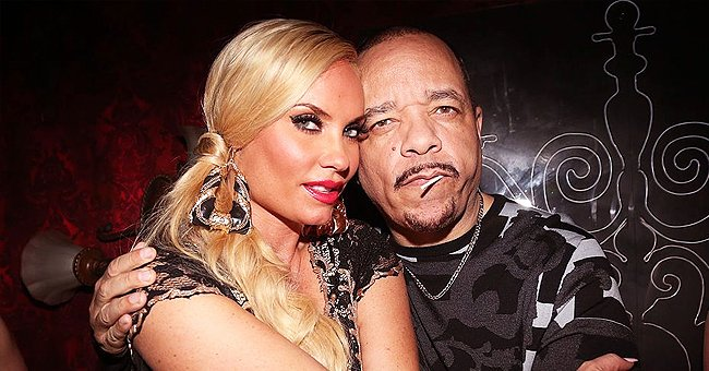 Ice-T's Wife Coco Shows Her Deep Cleavage in a Skimpy Top Leaning to Him at a Celebrity Boxing Event