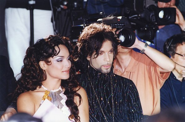 Prince and Mayte Garcia at the défilé Versace à Paris on 15 July 1999, in France | Photo: Getty Images