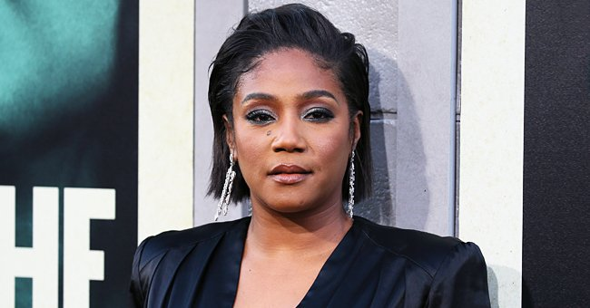 Tiffany Haddish Puts Her Legs on Display Flaunting Weight Loss in Floral Dress with Deep Slit