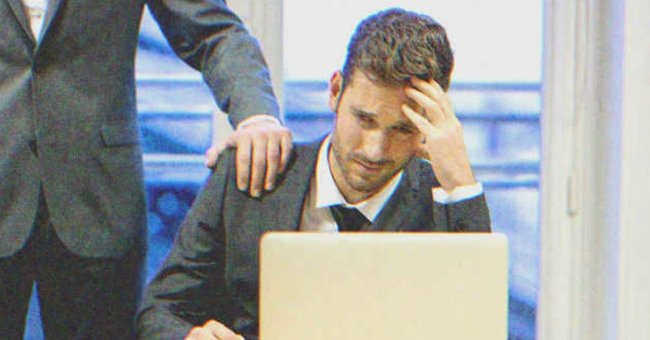 A man looks tired at work.   Source: Shutterstock