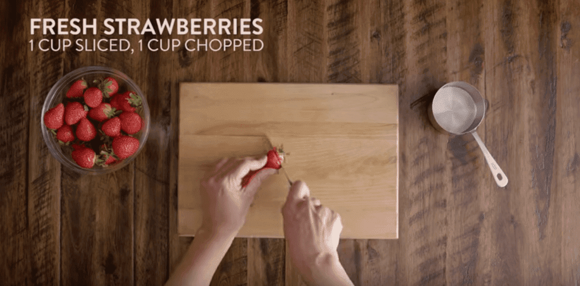Slice the strawberries. Image credit: YouTube/Kraft Recipes