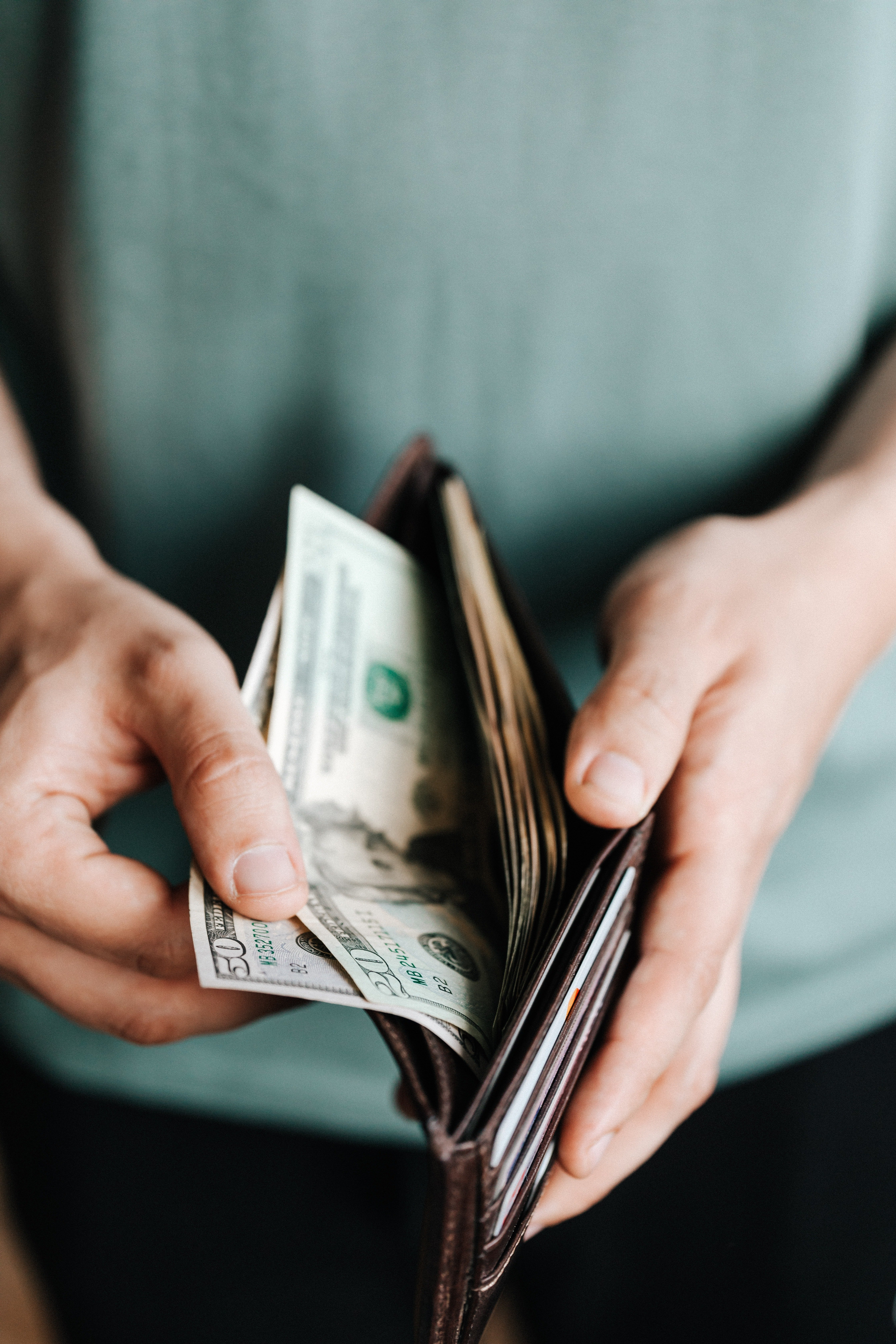 Photo of a wallet with cash.   Photo: Pexel