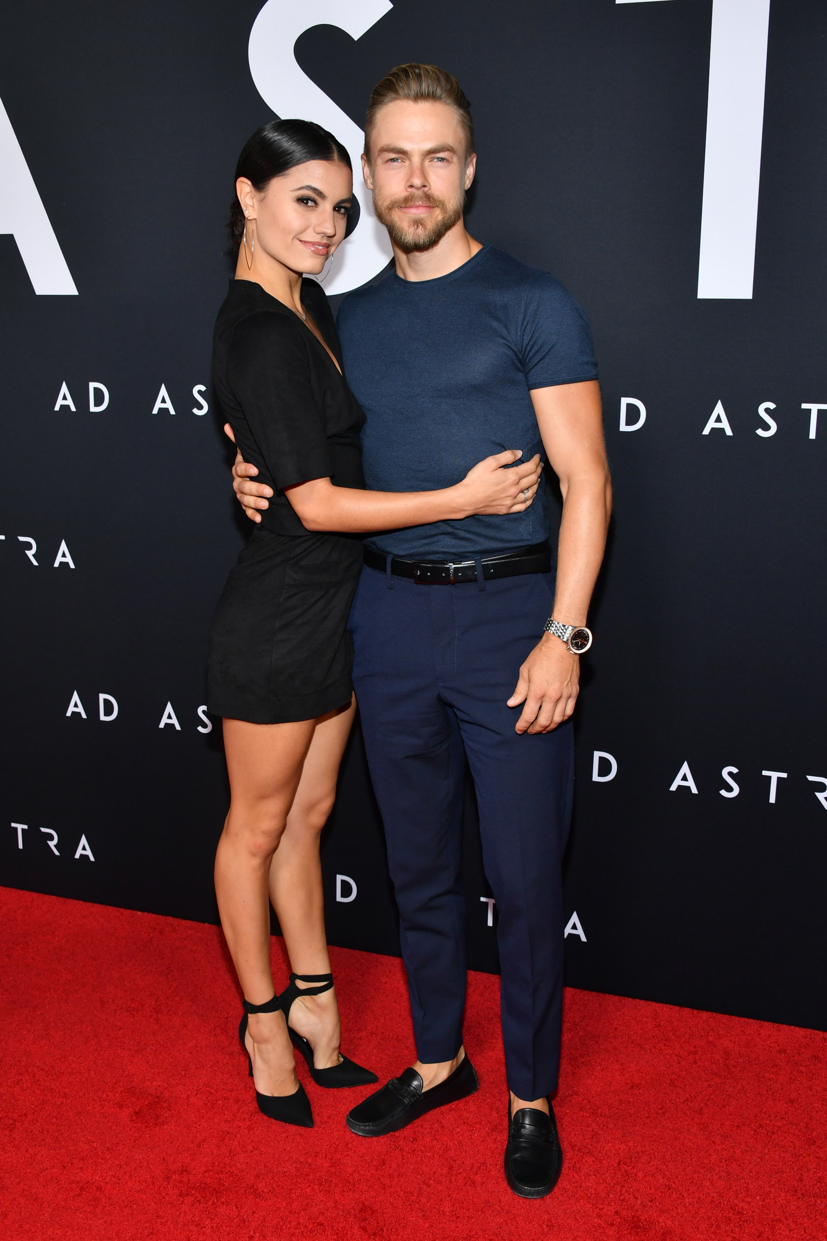 "Hayley Erbert and Derek Hough attend the premiere of ""Ad Astra"" in Los Angeles, California on September 18, 2019 