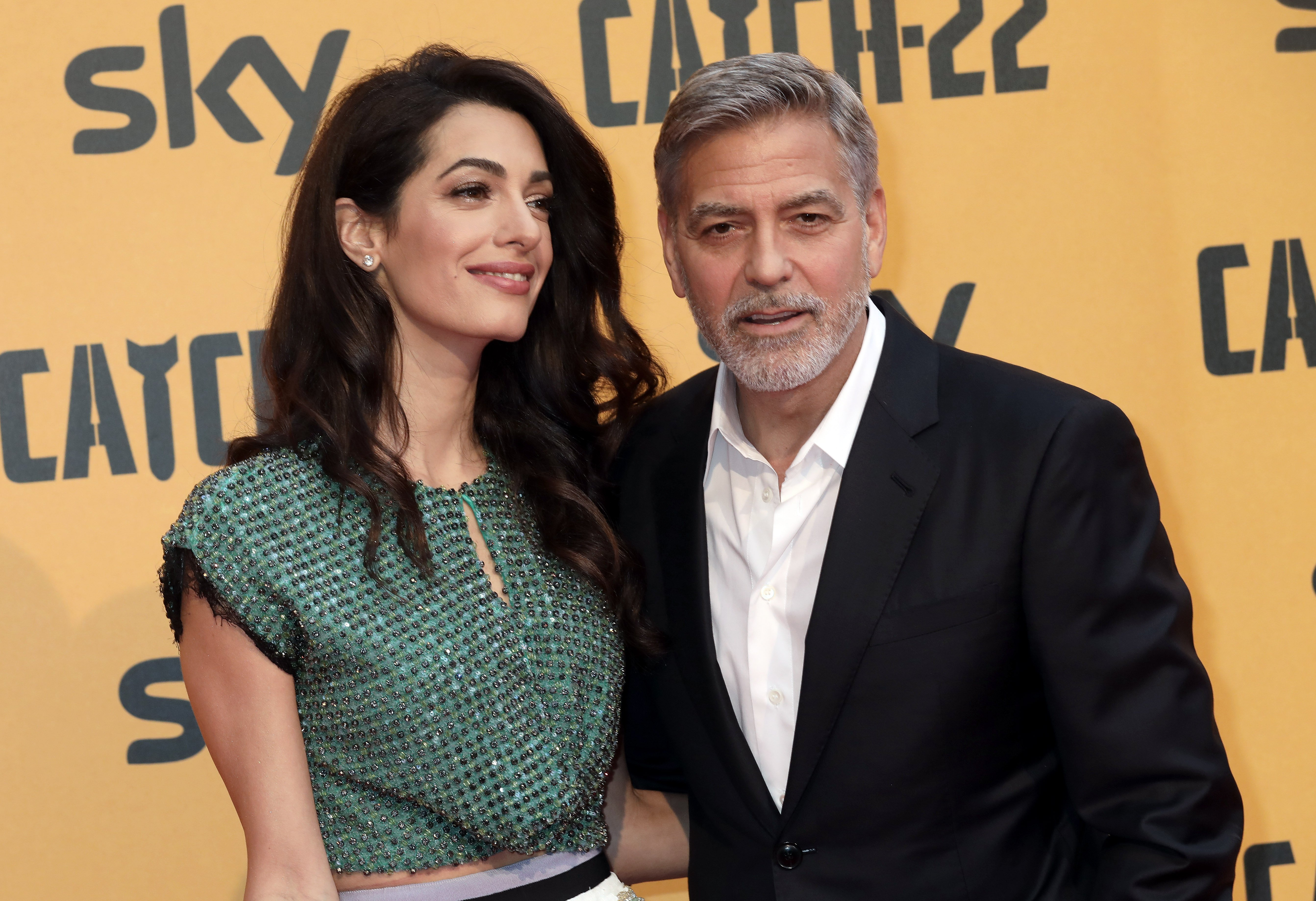 Amal and George Clooney attend 'Catch-22' Photocall on May 13, 2019, in Rome, Italy. | Source: Getty Images.