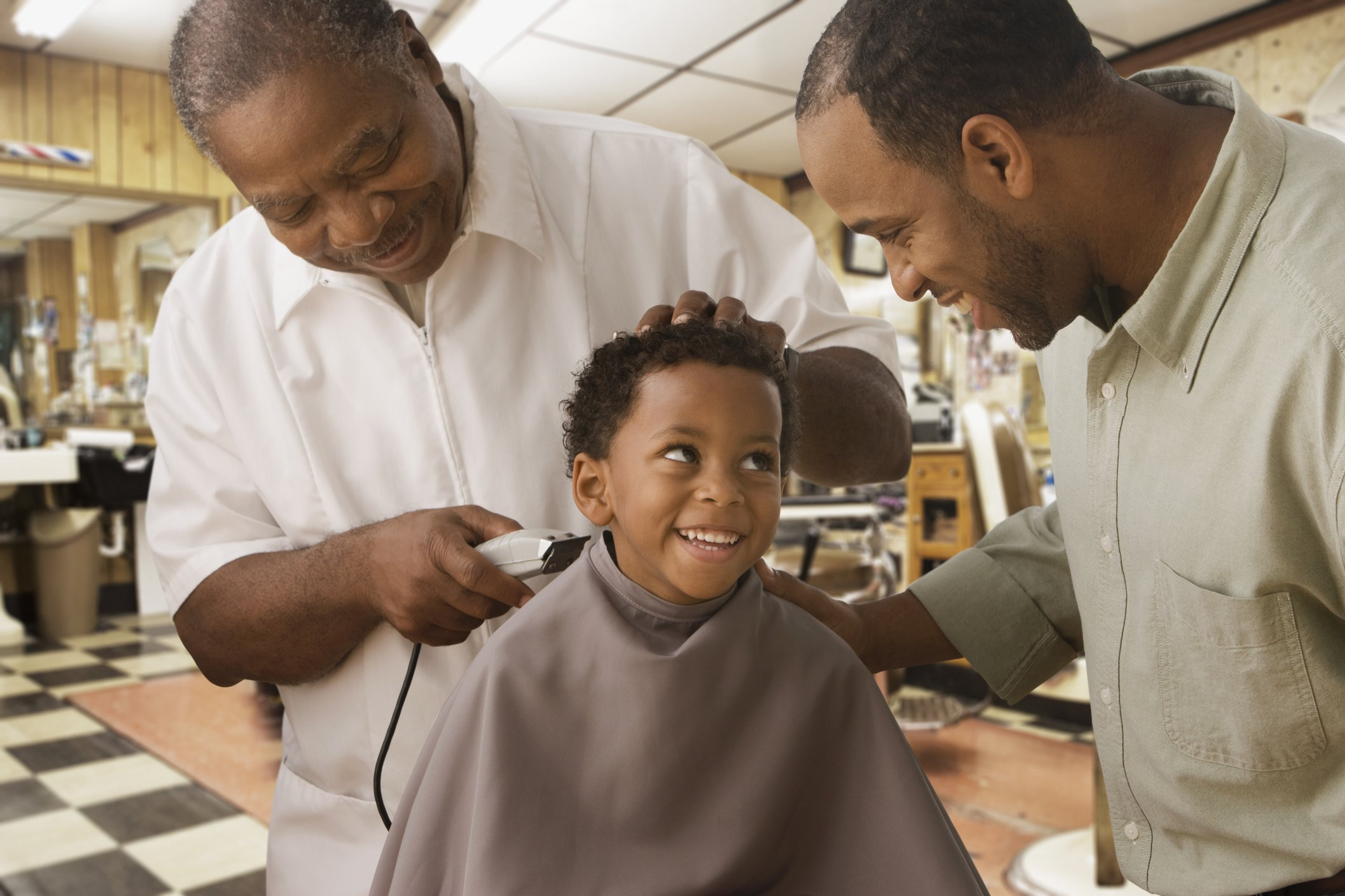 African father and son at barbershop | Photo: Getty Images