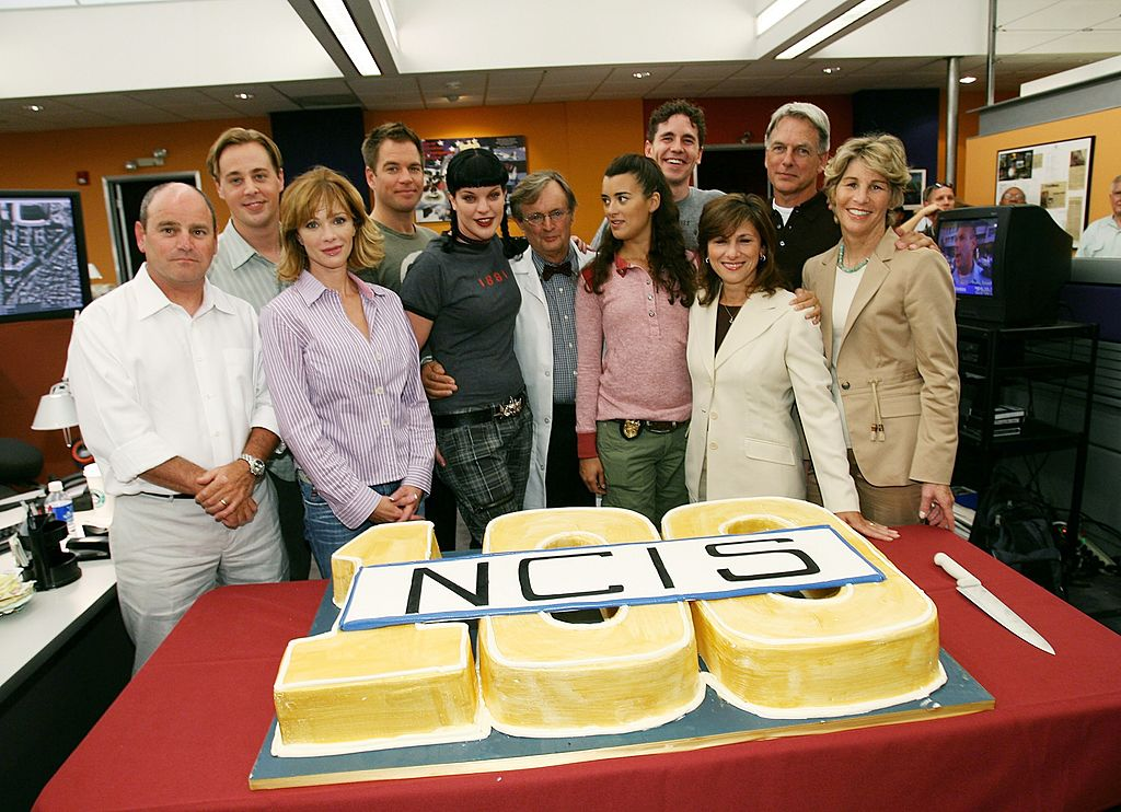 David Stapf President, CBS Paramount Network Television, actor Sean Murray, actress Lauren Holly, actor Michael Weatherly, actress Pauley Perrette, actor David McCallum, actress Cote de Pablo, actor Brian Dietzen, actor Mark Harmon, Nina Tessler, CBS Entertainment President and President of CBS Paramount Network Television Nancy Tellem attend the NCIS 100th Episode celebration at the Valencia Studios | Photo: Getty Images