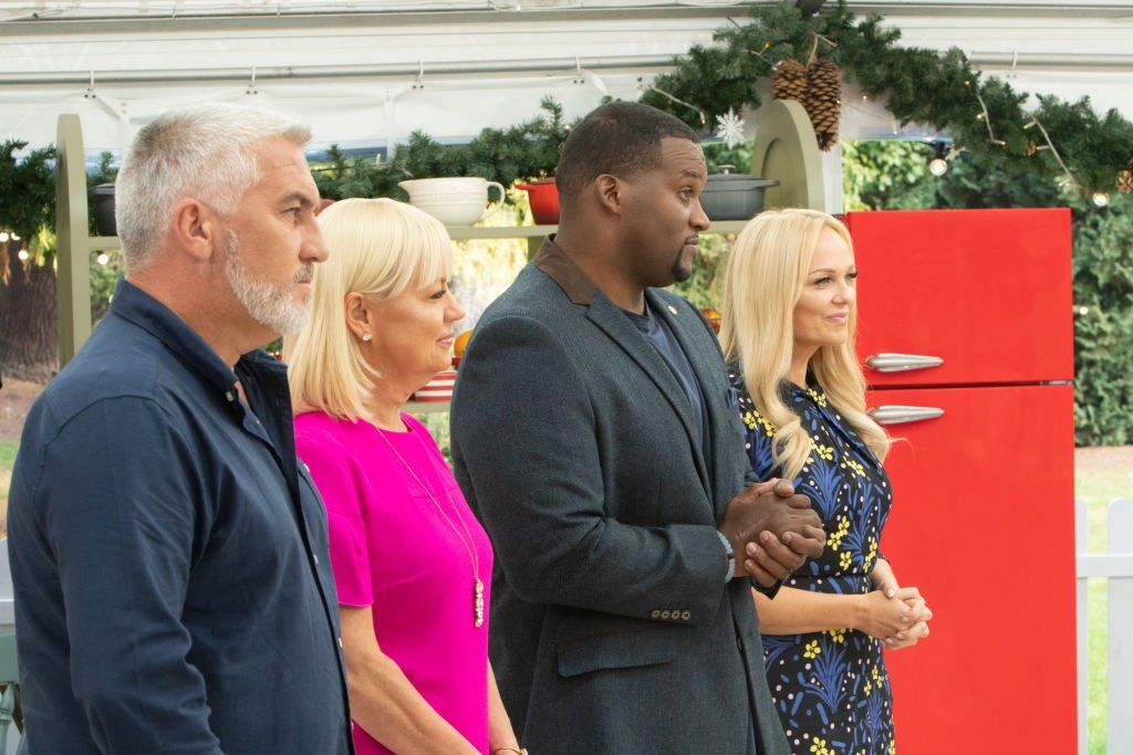 "Paul Hollywood, Sherry Yard, Anthony ""Spice"" Adams and Emma Bunton stand before contestants on ""The Great American Baking Show: Holiday Edition,"" on November 13, 2019 