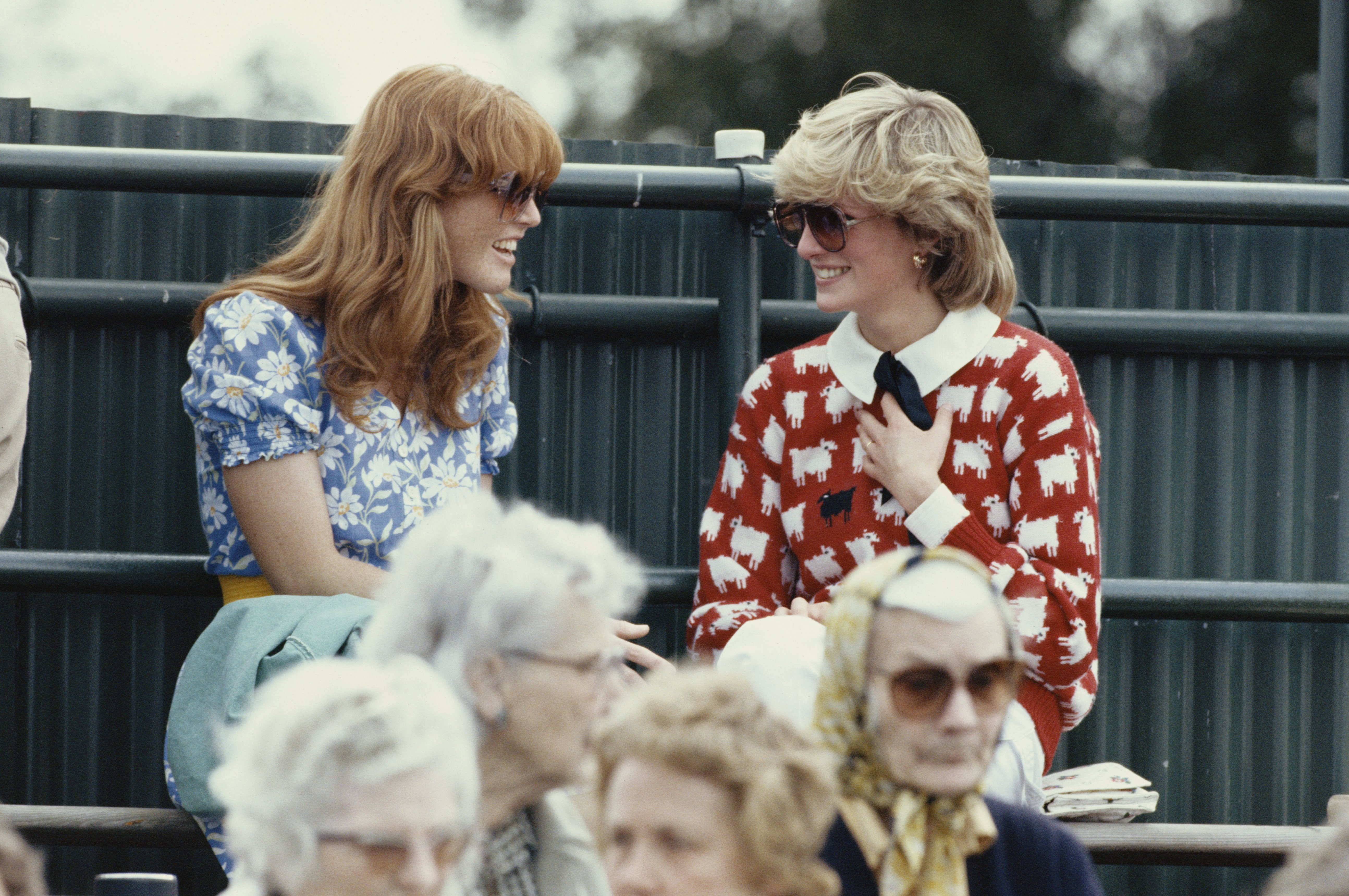 Princess Diana and Sarah Ferguson enjoy a chat while sitting in the crowd at the Guard's Polo Club, on June 1 1983, Windsor, England | Source: Georges De Keerle/Getty Images
