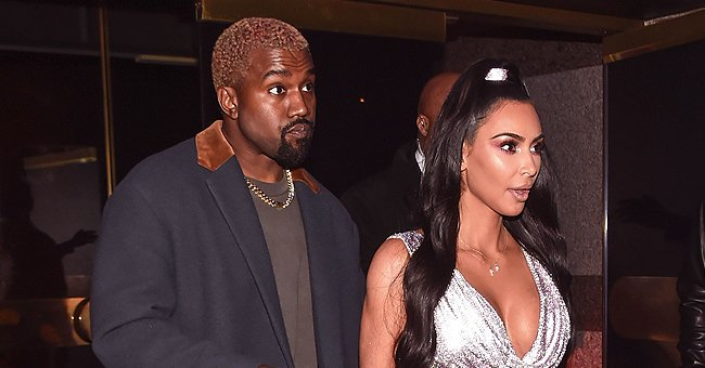 Kim Kardashian & Kanye West Look Chic Covering Their Mouths with Scarves in 2014 Photo
