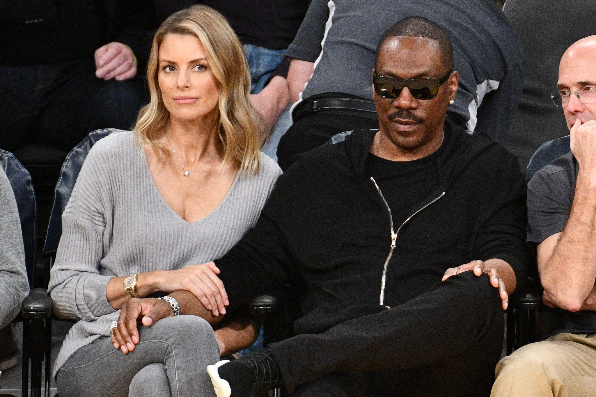 Eddie Murphy and Paige Butcher at a basketball game between the Lakers and the Utah Jazz in 2018 in Los Angeles | Source: Getty Images