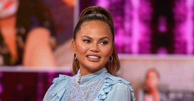 Pregnant Chrissy Teigen Poses in Mirror Wearing Kim Kardashian's Maternity Shapewear for SKIMS