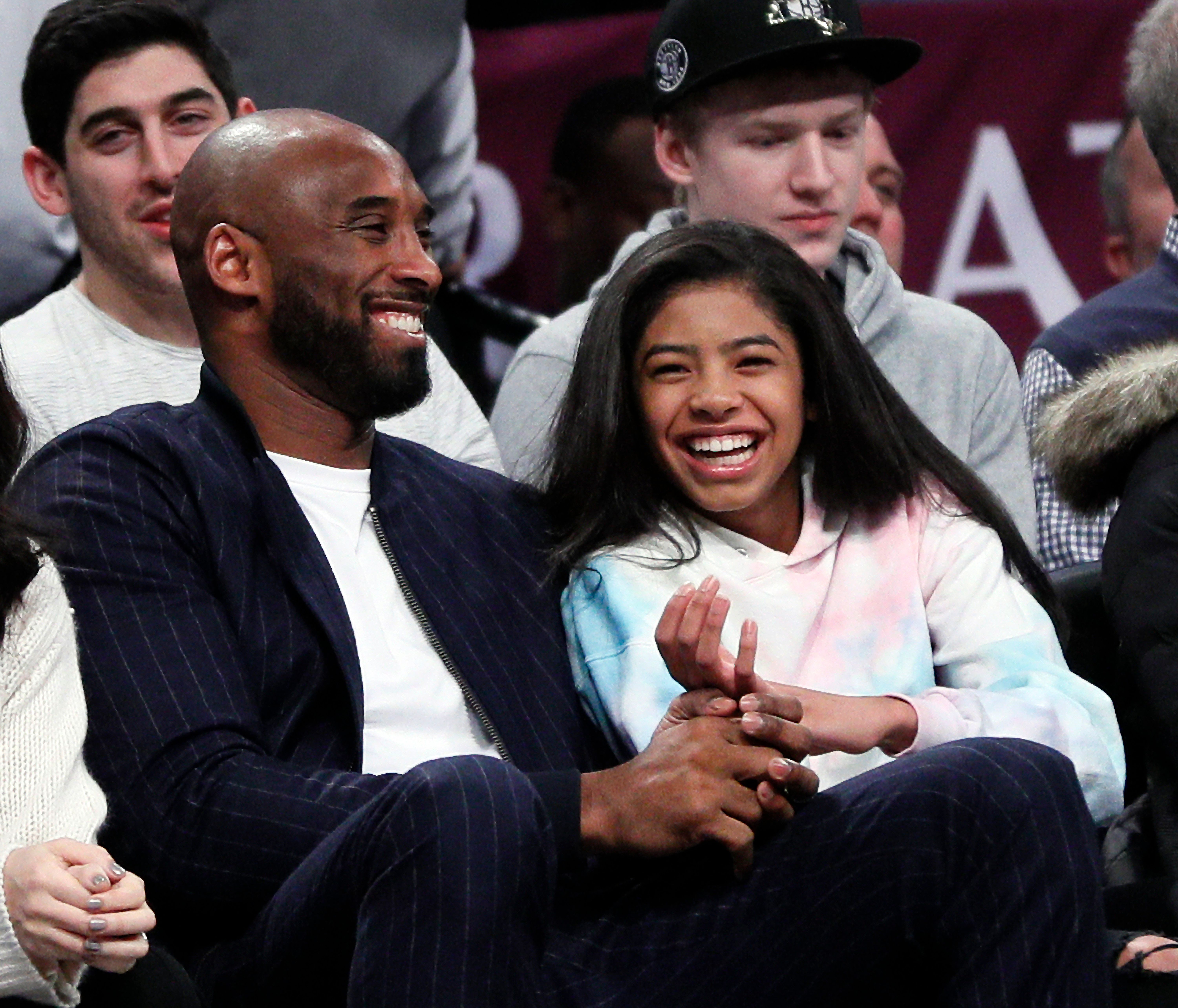 Kobe Bryant and his daughter Gigi, at an NBA basketball game between the Brooklyn Nets and Atlanta Hawks on December 21, 2019 | Photo: Getty Images