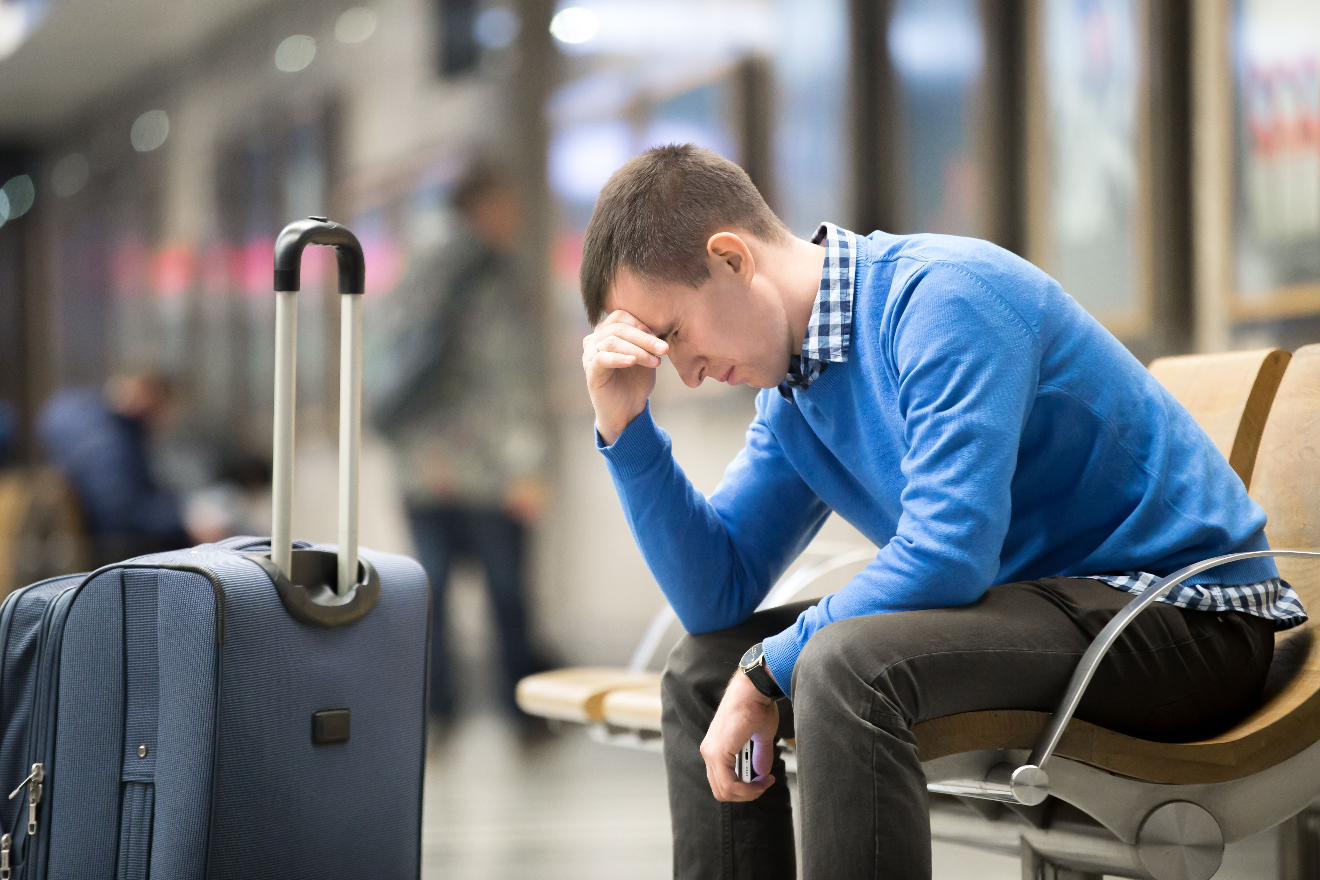 A man looking regretful while seated. | Source: Shutterstock