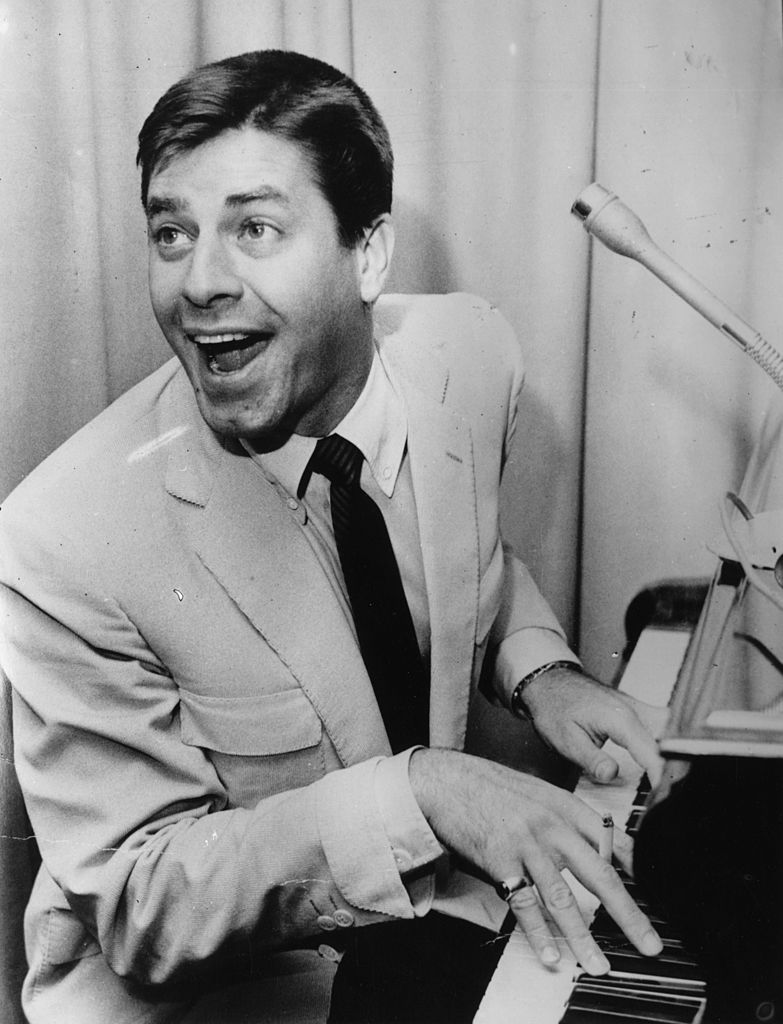 American comedy actor Jerry Lewis, with his mouth open at the piano., circa 1966.   Source: Getty Images