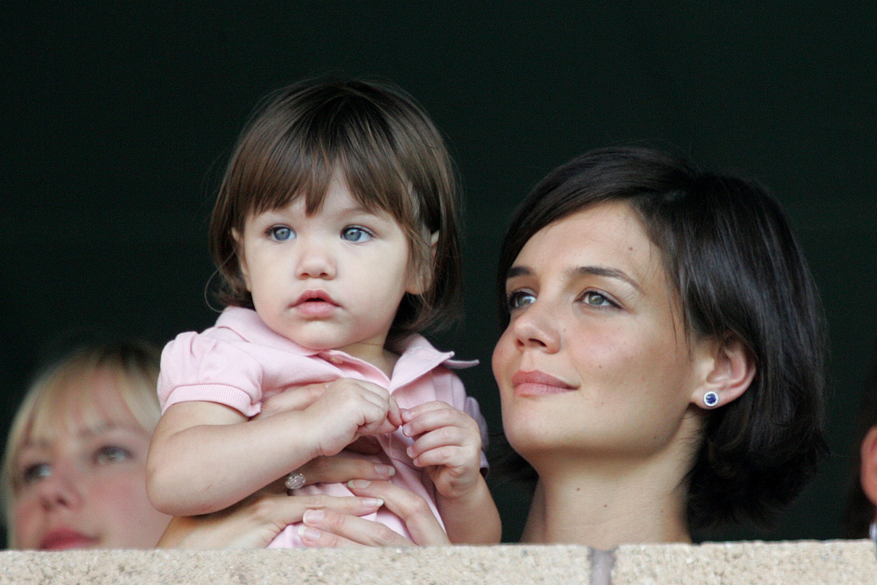 Katie Holmes and daughter Suri watch the LA Galaxy vs. Chelsea FC soccer game July 22, 2007, at the Home Depot Center in Carson, California. | Source: Getty Images.