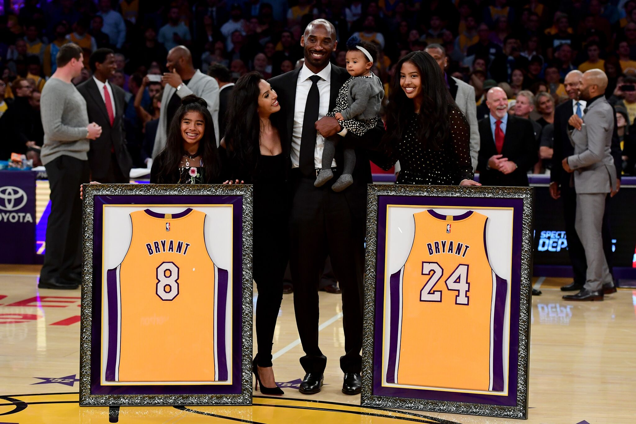 Kobe Bryant poses with his family at halftime after both his #8 and #24 Los Angeles Lakers jerseys are retired at Staples Center on December 18, 2017  | Getty Images / Global Images Ukraine