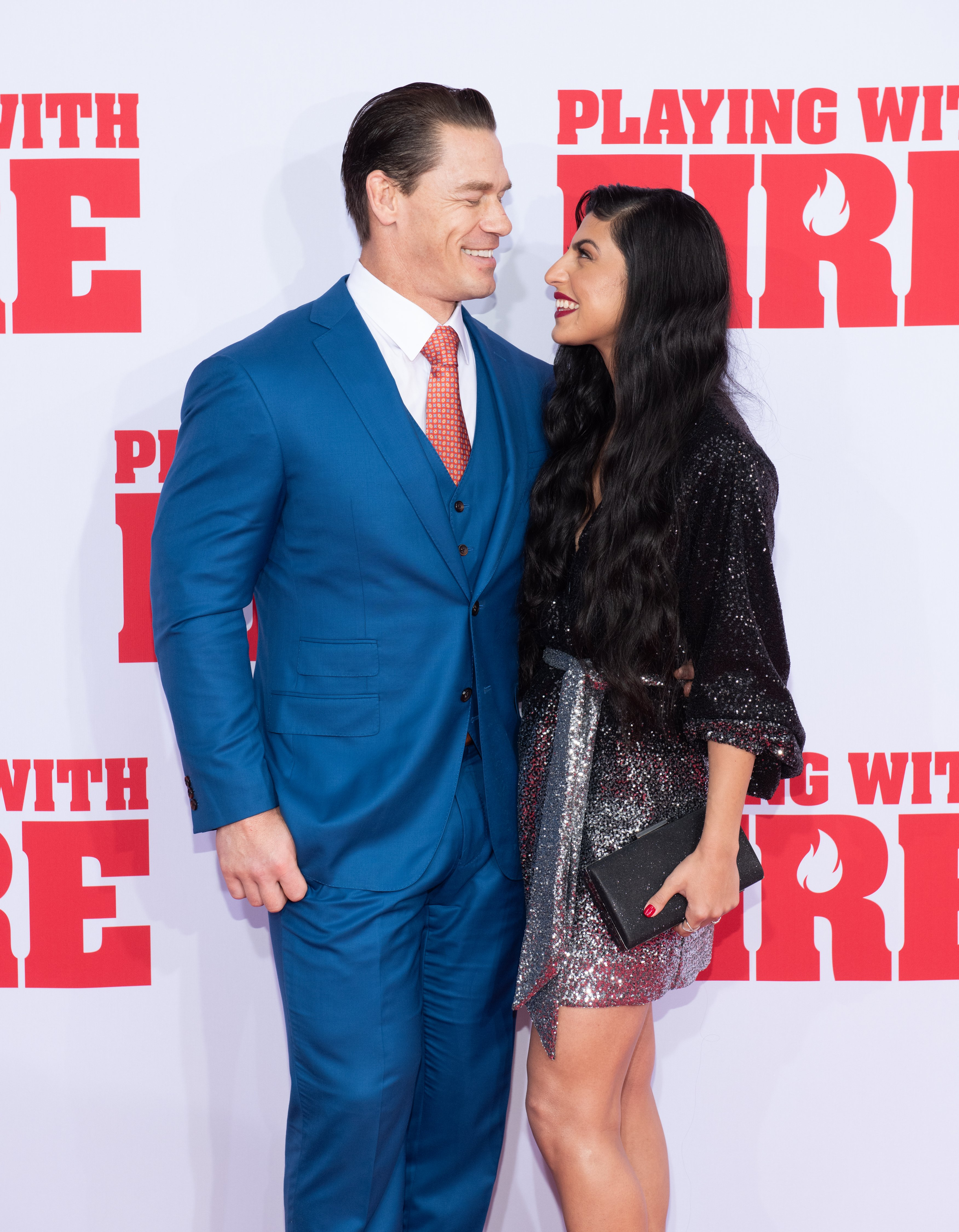 """John Cena and Shay Shariatzadeh attend the """"Playing With Fire"""" New York premiere at AMC Lincoln Square Theater on October 26, 2019, in New York City. 