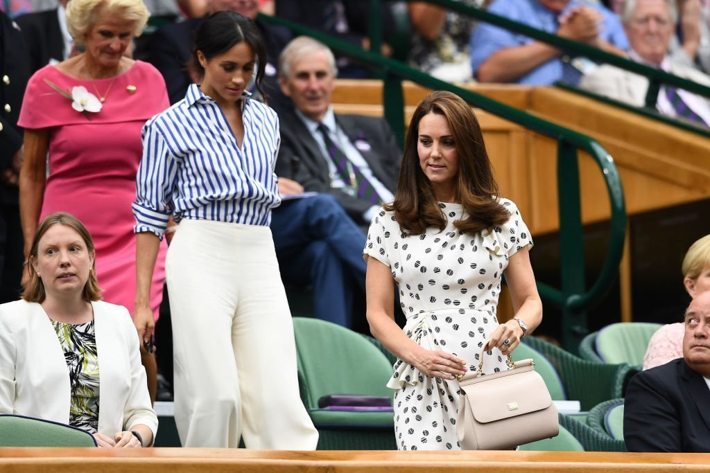 Catherine, Duchess of Cambridge (R) and Meghan, Duchess of Sussex attend day twelve of the Wimbledon Lawn Tennis Championships. | Photo: Getty Images