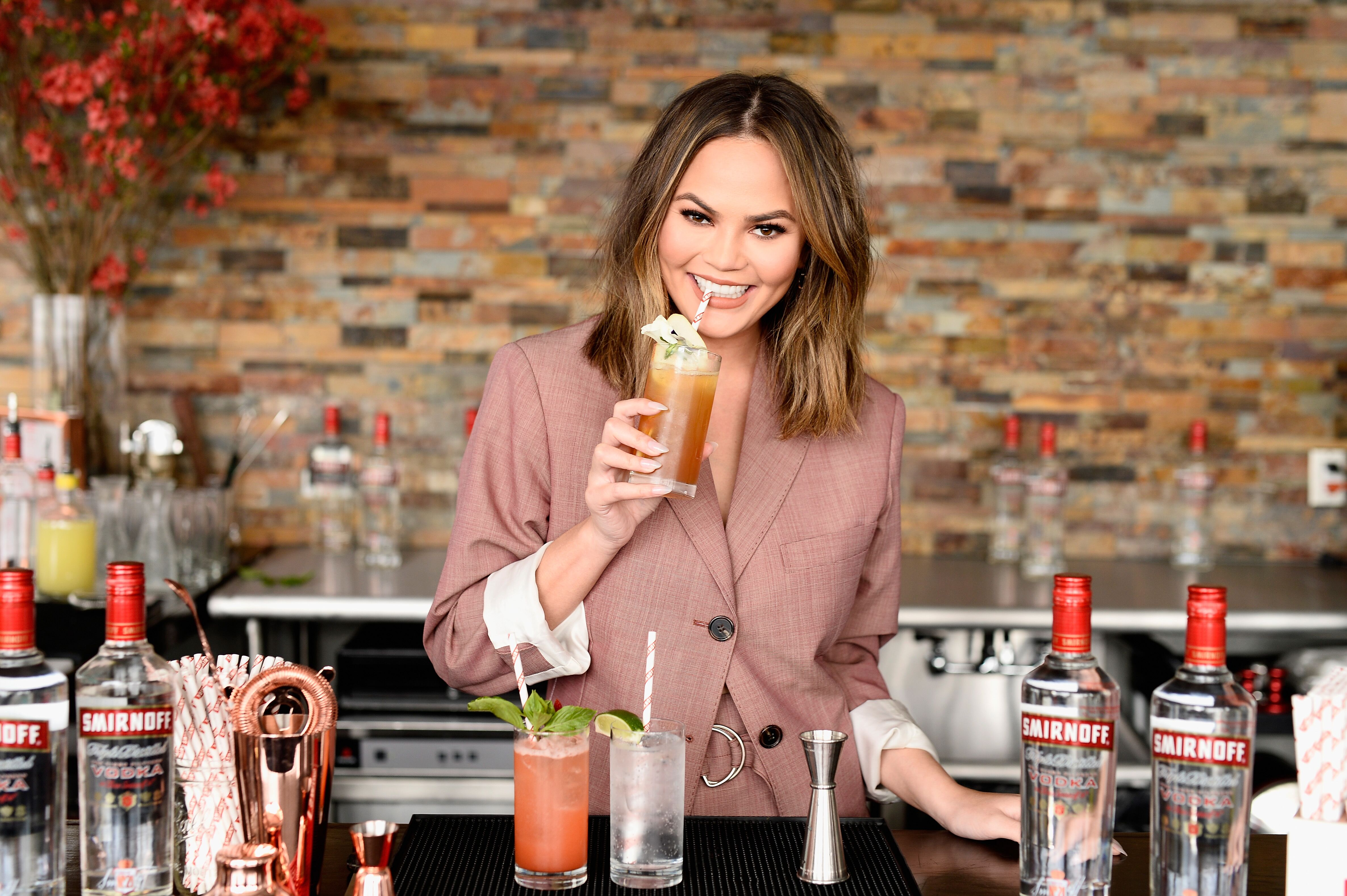 "Chrissy Teigen hosts a ""Cocktails with Chrissy"" Smirnoff event on April 27, 2017, in New York City 