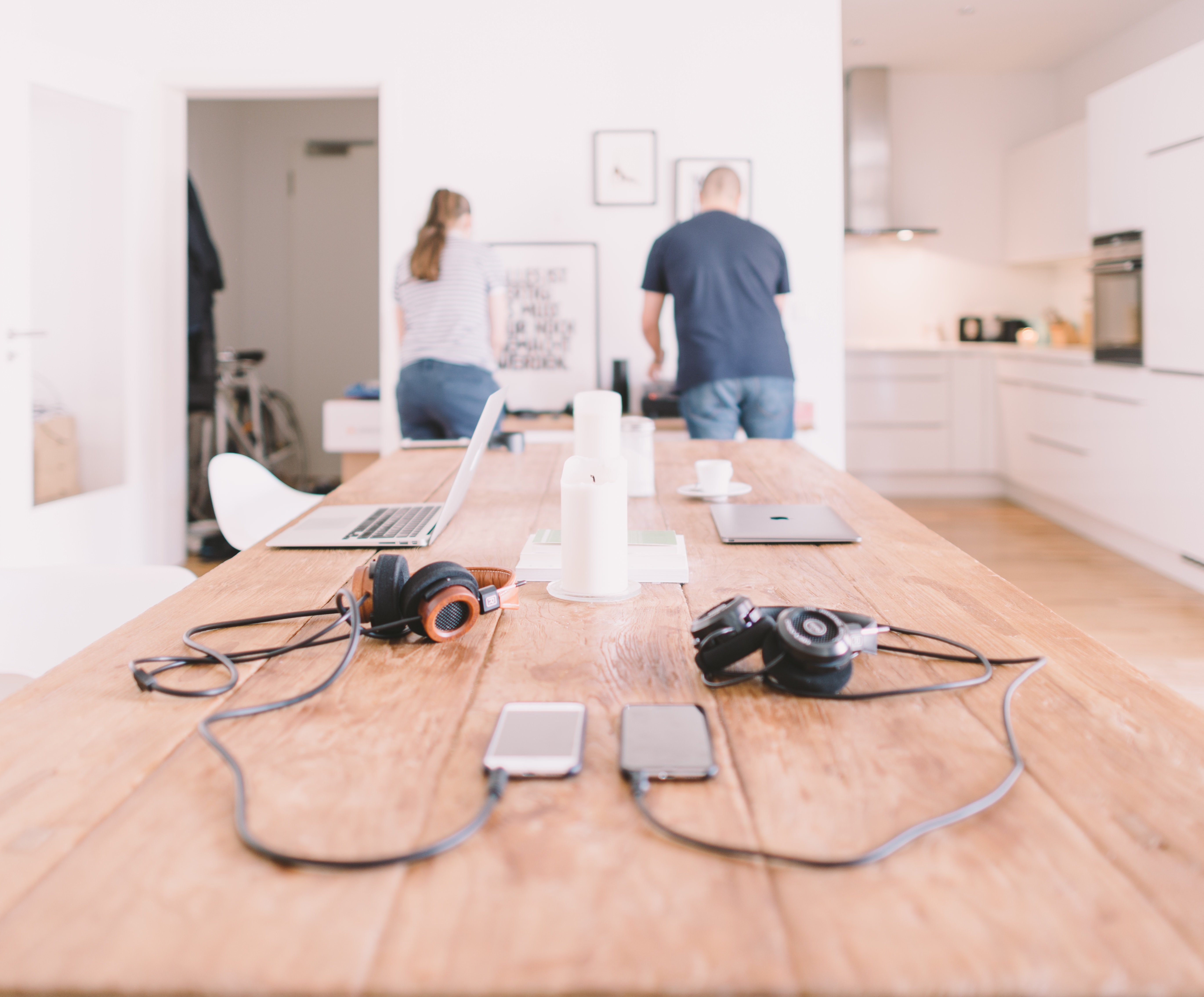 Two people working at the end of a room | Source: Unsplash.com