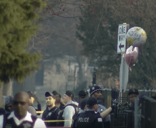 Two balloons floating outside the residence where the baby shower was taking place | Photo: CBS Chicago