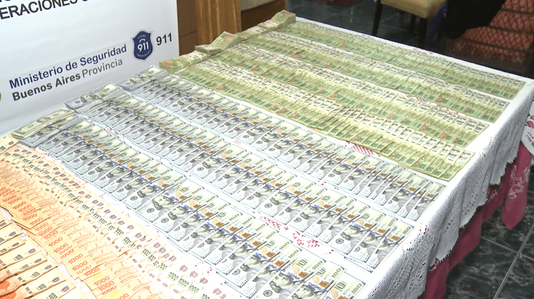 Police seized over $40,000. | Source: YouTube/Policia Imagenes